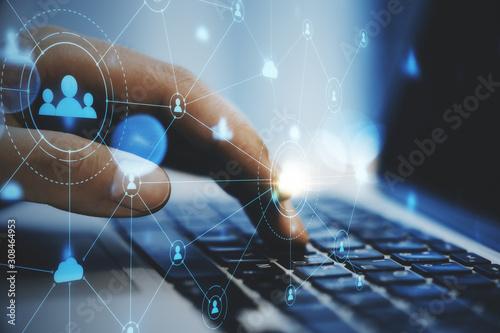 Fototapeta Hand using laptop on desktop obraz