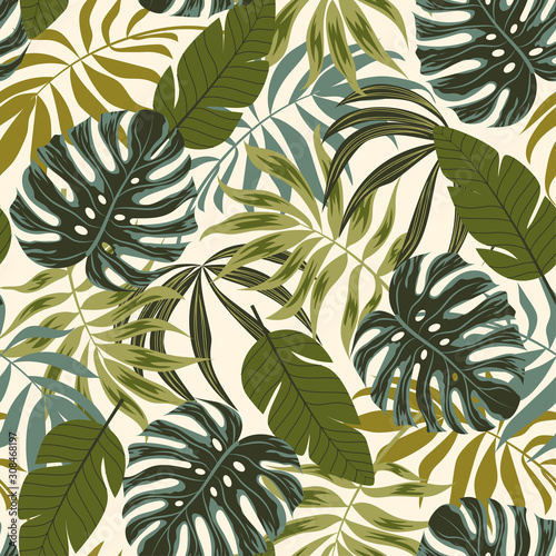 Fototapeta Trend seamless pattern. Tropical leaves and plants on white background. Illustration in Hawaiian style. Jungle leaves. Botanical pattern. Vector background for various surface. Exotic wallpaper. obraz na płótnie