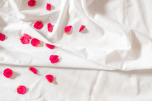 Top View Of Pink Rose Petals On White Bed Sheets On Honeymoon