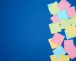 multicolored blank paper stickers of different colors on a dark blue background