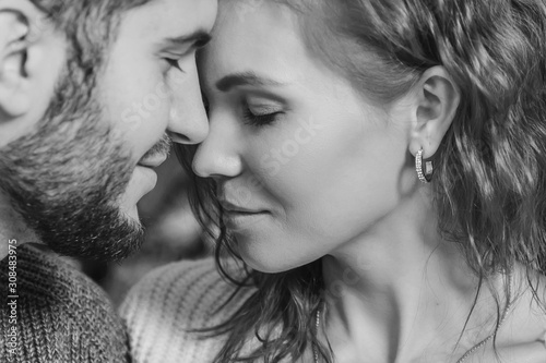 Fototapeta beautiful couple in love close up. intimacy between a man and a woman. the concept of the relationship obraz