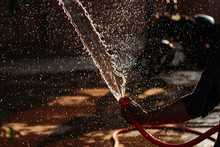 Closeup Shot Of A Hand Holding Water Hose