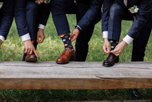 Stylish Men's Socks. Stylish Suitcase, Men's Legs, Multicolored Socks And New Shoes. Concept Of Style, Fashion, Beauty And Vacation