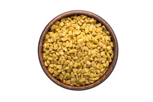Fenugreek Seed Spice In Wooden Bowl, Isolated On White Background. Seasoning Top View
