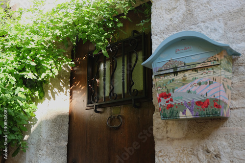 Photo A bright retro looking blue mailbox (letterbox) with a image of field Provence F