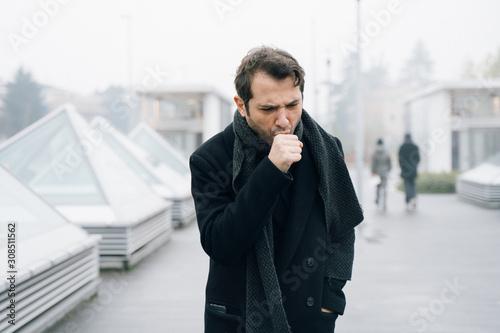 Fotografiet Sick man feeling bad during cold season