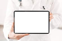 Close-up Of Blank Tablet Screen In Doctor Hands