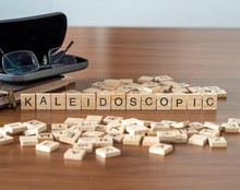 Kaleidoscopic The Word Or Concept Represented By Wooden Letter Tiles