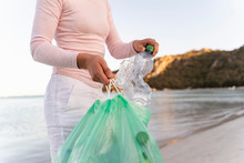Woman Collecting Empty Plastic...