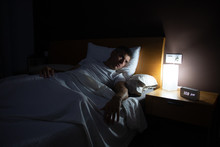 A Man With Insomnia Looks At T...