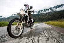 A Woman Rides Her Motorcycle O...