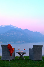 Armchairs And Red Wine With Views Of Lake Como At Sunset, Lombardy, Italian Lakes