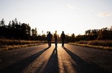 Silhouette Of Family Walking D...