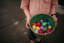 Boy Holding Plastic Eggs In Ba...