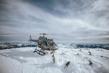 Helicopter Landed On Snowy Mou...