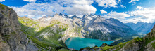 Aerial Panoramic Of Oeschinensee Lake Surrounded By Woods In Summer, Bernese Oberland, Kandersteg, Canton Of Bern