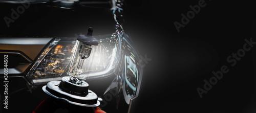 Obraz Modern sport car headlight with flare on the road. - fototapety do salonu