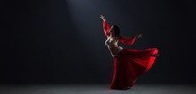 Woman In Red Arabic Dress Danc...