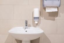 Sink Next To Soap Dispenser Pump And Paper Towel Dispenser