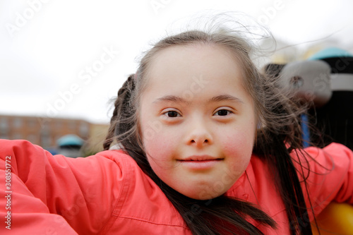 Fotografie, Obraz  Little girl having fun on the playgound