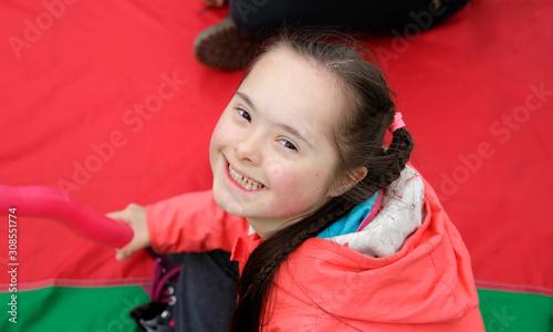 Fotografie, Obraz  Little girl on the background of red