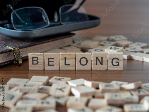 belong the word or concept represented by wooden letter tiles Wallpaper Mural
