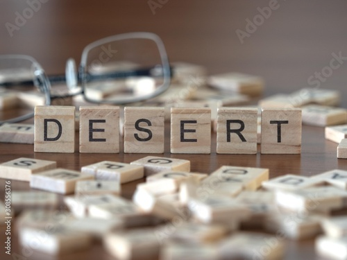 Photo  desert the word or concept represented by wooden letter tiles