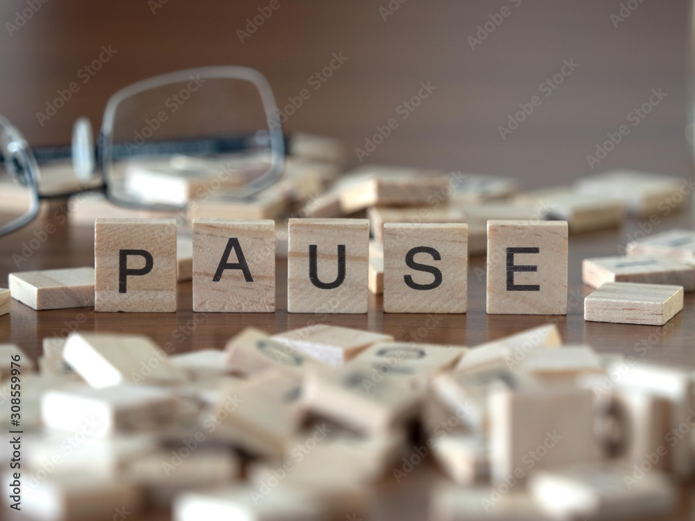 Fototapeta pause the word or concept represented by wooden letter tiles