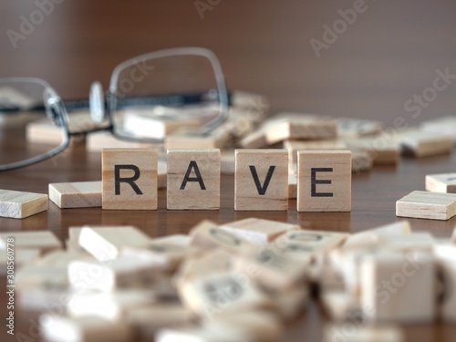 Photo rave the word or concept represented by wooden letter tiles