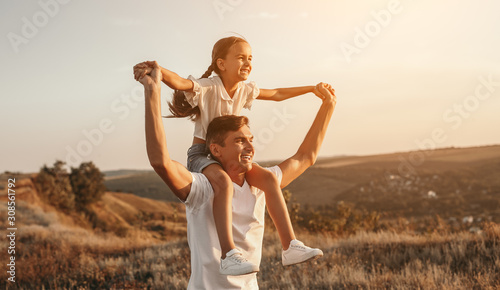 Father and daughter enjoying freedom in nature