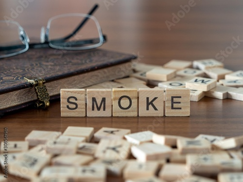 smoke the word or concept represented by wooden letter tiles Tablou Canvas
