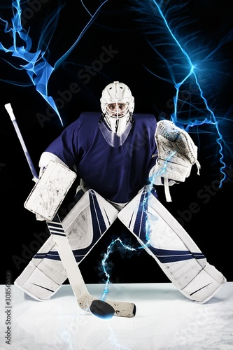 Cuadros en Lienzo Hockey goalie stands UNDER BLUE FLASHES  LIGHTNING ready to catch the puck