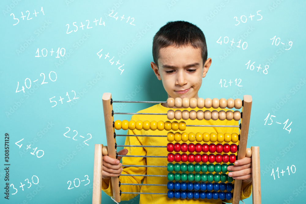 Fototapeta Child tries to solve mathematical problem with abacus. Cyan background