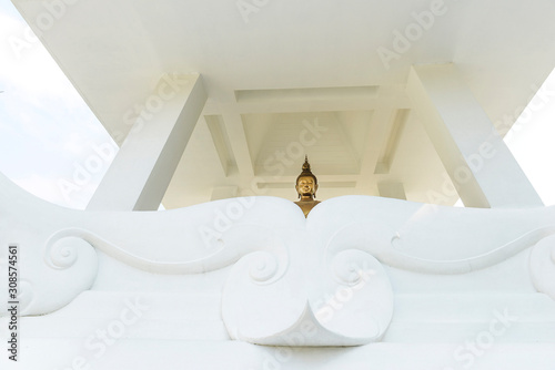White temple with small Buddha