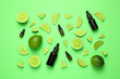 canvas print picture - Flat lay composition with lime essential oil on green background