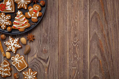 Obraz Boże narodzenie - tło z pierniczkami i miejscem na tekst - fototapety do salonu