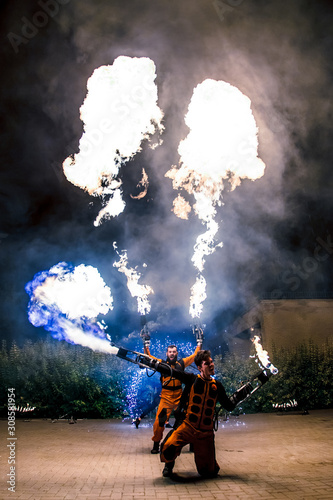 Fotomural Fire show, dancing with flame, male master fakir with fire works, performance ou