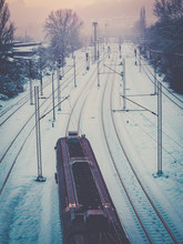 Train Passing Through The Snow Covered Train Tracks