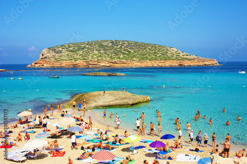 the famous and fantastic popular beach of Cala Comte in Ibiza, Balearic island. Beautiful for summer holidays