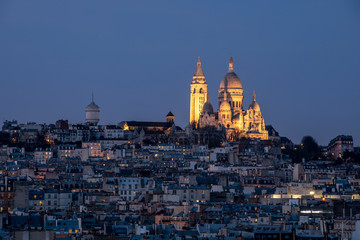 Paris, France - December 8, 2019: Sacre Coeur basilica viewed from Galeries Lafayette roof in Paris