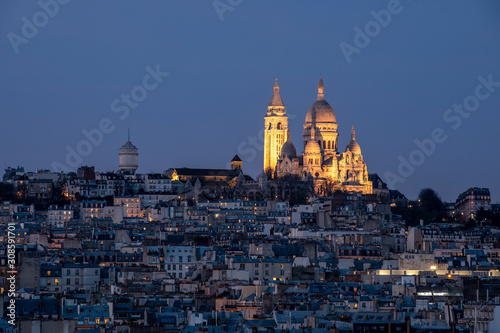 Fotografie, Obraz Paris, France - December 8, 2019: Sacre Coeur basilica viewed from Galeries Lafa