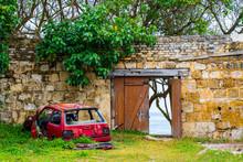 Old Damaged Red Motor Car Shel...