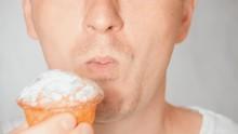 Close Up Lower Part Face Young Fair Man Has Dessert Eating A Cupcake