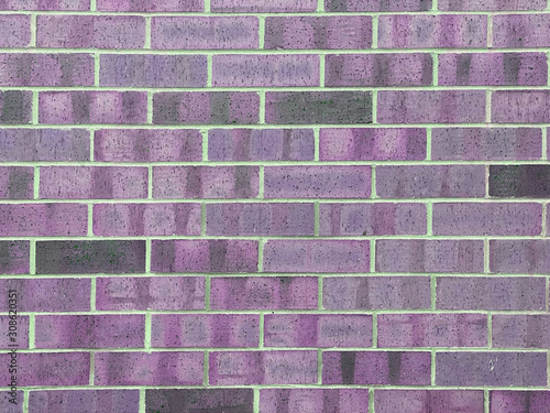 brick wall texture with purple hue
