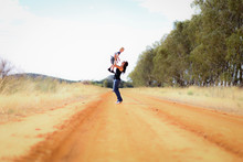 Mother And Son Mucking Around On Country Road In Central Victoria, Australia