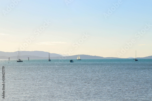Seaside view of yachts on the water off the coast of Airlie Beach, Queensland Au Wallpaper Mural