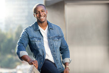 Portrait Lifestyle Head Shot Of An African American Male In A Blue Jean Jacket On A City Urban Rooftop, Nice Smile