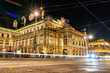 long time exposure of the illuminated Vienna State Opera in Austria at night, light trails