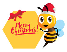 Merry Christmas. Cartoon Cute Bee Pointing To Honeycomb Signboard With Merry Christmas Lettering - Vector Character Illustration Isolated