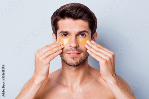 Cuadros en Lienzo Close-up portrait of his he nice attractive bearded brunette guy applying using